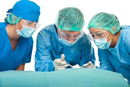 surgical cap: Three surgeons wearing sterile uniforms and being in operation isolated on white background
