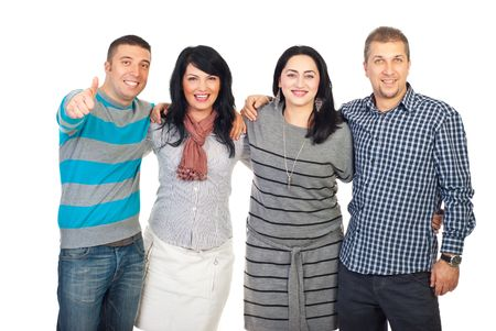 Laughing group of friends standing in a long embrace and one man giving thumb up isolatedon white background Stock Photo - 8203355
