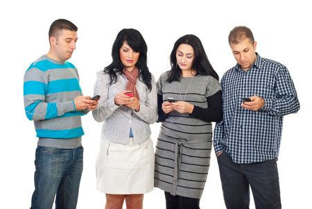 sending: Group of four people in a row using their phones  to writing or reading SMS isolated on white background Stock Photo