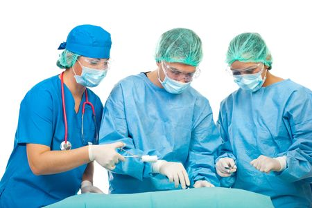 Three surgeons  operating  in operation room  isolated on white background photo