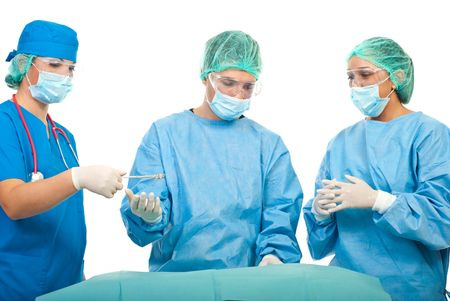 Three busy surgeons operating in operation room  photo
