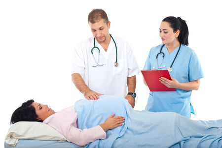 prenatal preparation doctor examine pregnant belly in hospital and a nurse woman standing near bed - Prenatal Nurse