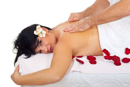 Masseur giving soft and deep massage same time to a back woman at spa salon photo