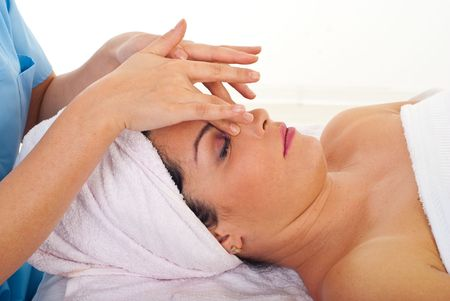 Woman receiving a relaxation facial massage at spa salon photo