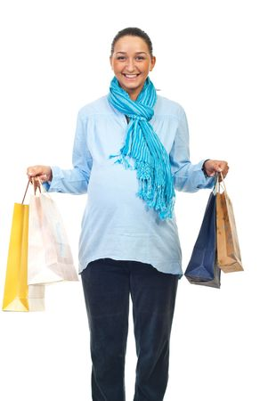 Happy pregnant woman holding shopping bags isolated on white background photo