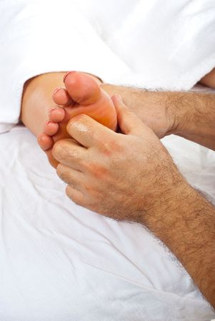 Health worker giving reflexology massage to woman feet  Stock Photo - 8270237