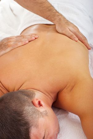 Man receiving a spa relaxing massage from a professional  masseur photo