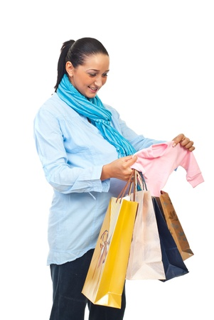 Pregnant woman bought baby clothes and holding shopping bags isolated on white background photo