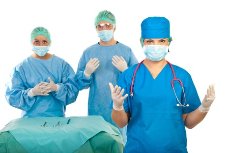 surgical glove: Surgeon woman and her surgeons team preapring for operation
