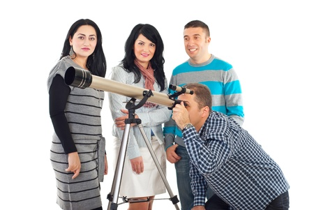 they are watching: Four friends in a group having fun while one man watching though telescope and they waiting their turn