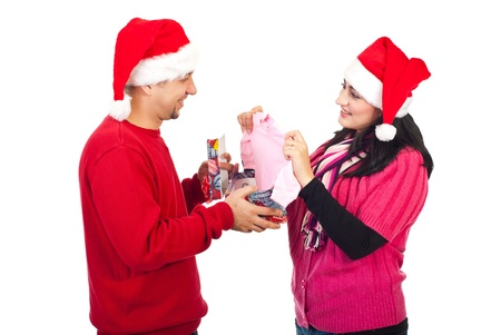 Happy husband receive a surprising Christmas gift from his wife,they will be parents photo