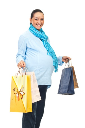 Beautiful laughing pregnant woman holding shopping bags isolated on white background photo
