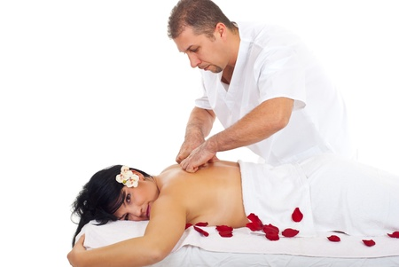 Beautiful woman receiving a relaxing back massage at spa retreat from a professional masseur photo