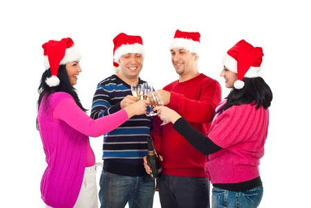Four friends group wearing Santa hats and  toasting with champagne to celebrate Christmas photo