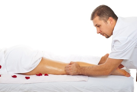 Health worker man giving anti cellulite massage to  a woman legs photo