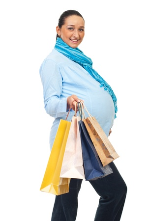 Cheerful pregnant woman  nine months holding shopping bags isolated on white background photo
