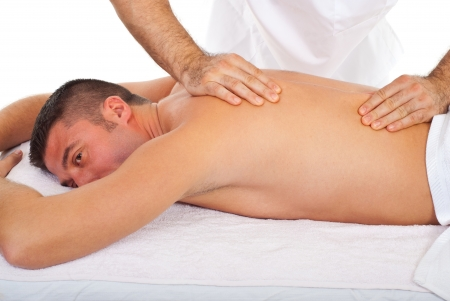 therapeutic massage: Man receive torso massage from a professional masseur in a spa resort