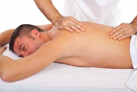 masseur: Man receive torso massage from a professional masseur in a spa resort
