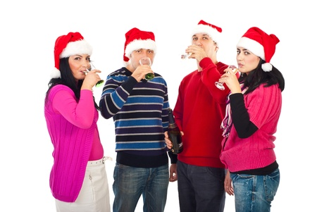 Group of friends drinking champagne and celebrate Christmas night isolated on white background photo