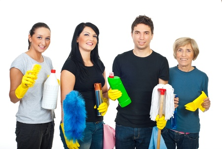 helpers: Happy team of cleaning  workers holding cleaning products and their equipment and offering professional cleaning services