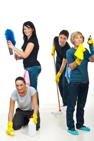 cleaning team: Feliz equipo de cuatro personas sonrientes limpiando su casa, cada persona hacer algo diferente  Foto de archivo