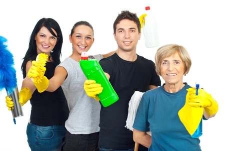 Cheerful team  of cleaning service workers showing  their products for clean house isolated on white background