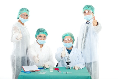 doctor giving glass: Successful team of scientists people giving thumbs up on laboratory