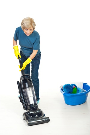 Senior housewife using vacuum cleaner to cleaning wooden floor Stock Photo - 8333073