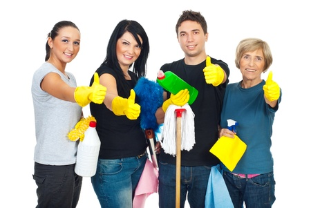 Successful cleaning people teamwork giving thumbs up and holding products for clean house photo