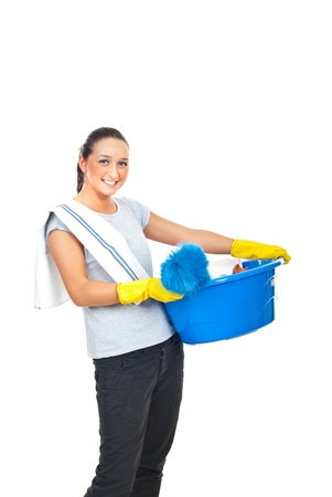 Happy housewife carrying cleaning products isolated on white background photo