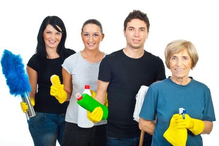 cleaning team: Cheeerful equipo de cuatro personas, con productos de limpieza aislados sobre fondo blanco Foto de archivo
