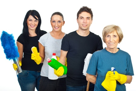 Cheeerful team of four people holding cleaning products isolated on white background photo