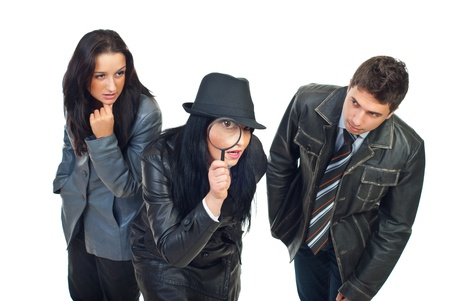 Three young detectives  in leather jackets make investigation isolated on white background photo
