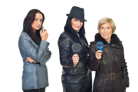 Team of three detectives women holding recorder and magnifying glass isolated on white background photo