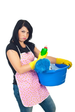 Miffed woman holding cleaning products isolated on white background
