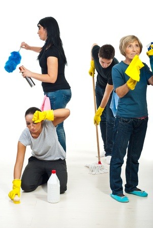 Four people teamwork working hard to cleaning house and all of them do different work photo