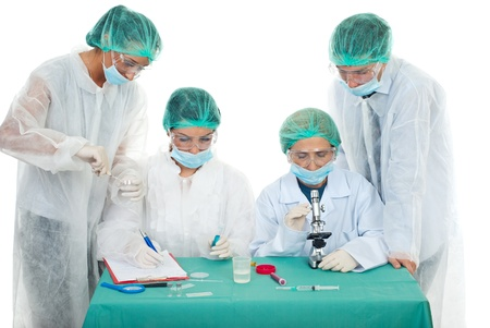 Four people researchers teamwork working in laboratory photo