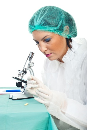 Pharmacist woman making experiments for  medicines in laboratory photo
