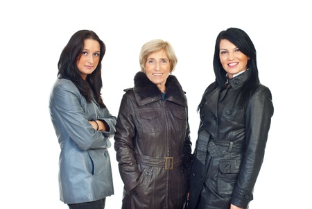 Three beautiful women different ages wearing leather jackets and standing in a line isolated on white background photo