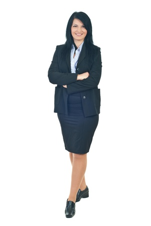 businesswoman skirt: Full length of smiling business woman standing with hands crossed isolated on white background