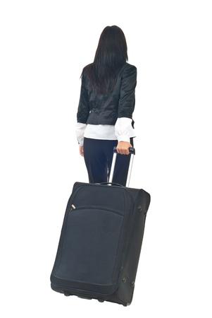 going in: Realizar copia de seguridad de la empresaria o azafata va en un viaje y llevar equipaje aislado sobre fondo blanco