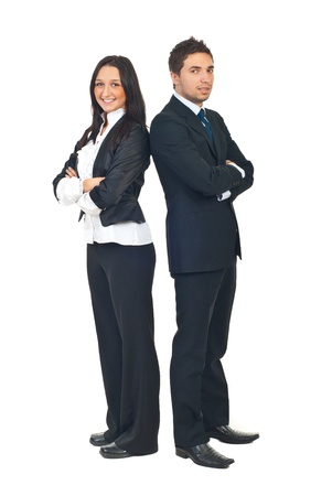 Full length of two young business people standing back to back with hands crossed isolated on white background