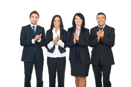 Four business people team standing in a row and clapping isolated on white background photo