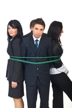 縛られ一緒に概念の囚人のビジネス人々 のグループの仕事に孤立した白い背景 写真素材