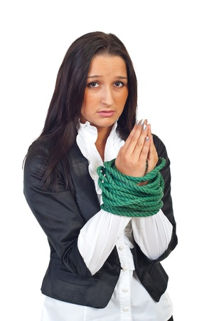 Tied businesswoman with worried face praying isolated on white backgrond photo