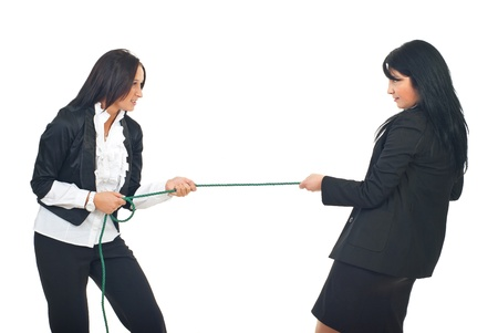 Two business women in competition pulling rope isolated on white background Stock Photo - 8333159
