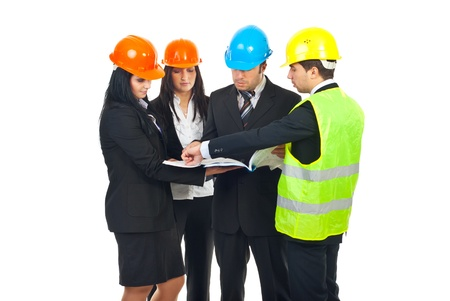 hard hats: Group of four architects with hard hats  having conversation and holding blueprints isolated on white background