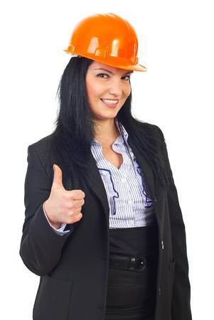 Portrait of happy architect woman with orange hard hat giving thumb up isolated on white background Stock Photo - 8333188