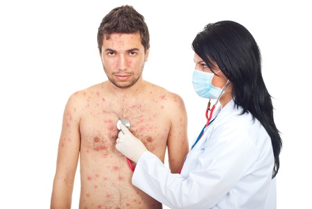 Physician woman assessing man with chickenpox isolated on white background photo