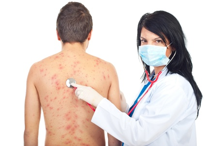 Doctor woman examine patient male with chickenpox isolatedon white background photo